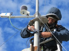 Checking the equipment at top of mast